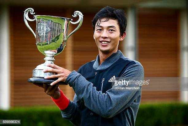 Yen-Hsun Lu of Taipei poses with the trophy after winning his Men's Final match against Marius Copil of Romania during day nine of the Aegon Surbiton...