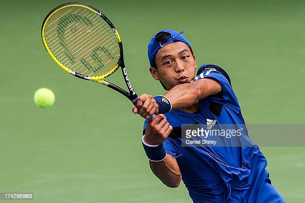 Yen-Hsun Lu of Taipei returns a ball against Kevin King at the BB&T Atlanta Open in Atlantic Station on July 23, 2013 in Atlanta, Georgia. Lu won the...