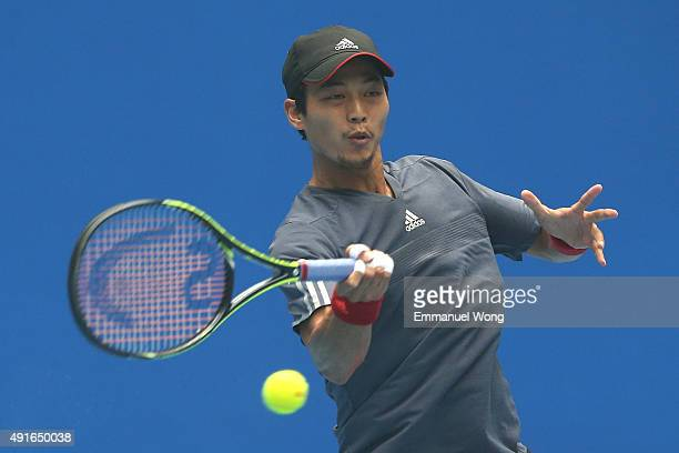 YenHsun Lu of Taipei returns a ball against Viktor Troicki of Serbia during the day five of the 2015 China Open at the China National Tennis Center...