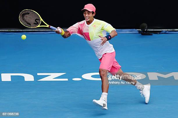 Yen-Hsun Lu of Taiwan plays a forehand in his match against Karen Khachanov of Russia on day nine of the ASB Classic on January 10, 2017 in Auckland,...
