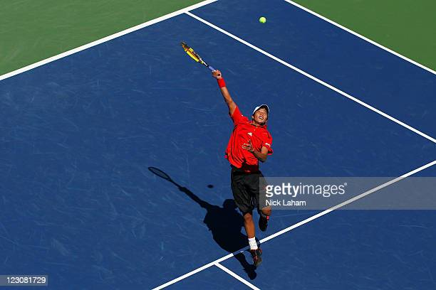 Yen-Hsun Lu of Taiwan returns a shot against Jo-Wilfried Tsonga of France during Day Two of the 2011 US Open at the USTA Billie Jean King National...