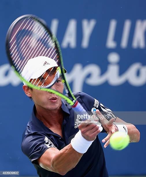 Yen-Hsun Lu of Taiwan returns a shot to Andreas Seppi of Italy during the men's quarterfinal match of the Winston-Salem Open at Wake Forest...
