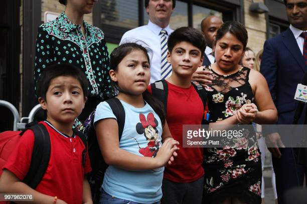 Yeni Maricela Gonzalez Garcia stands with her children 6 yearold Deyuin 9 yearold Jamelin and 11 yearold Lester as she and her lawyer speak with the...