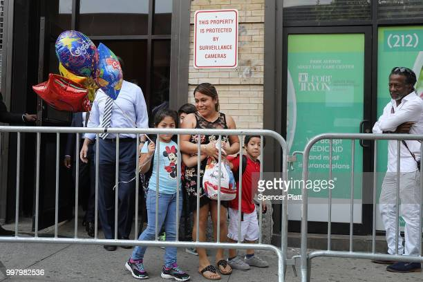 Yeni Maricela Gonzalez Garcia walks out with her children from the East Harlem Cayuga Centers on July 13 2018 in New York City Gonzalez Garcia from...