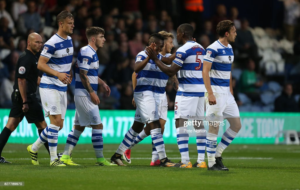 Yeni Ngbakoto of Queens Park Rangers is congratulated by team mates after scoring his sides first goal during the Carabao Cup first round match between Queens Park Rangers and Northampton Town at Loftus Road on August 8, 2017 in London, England.