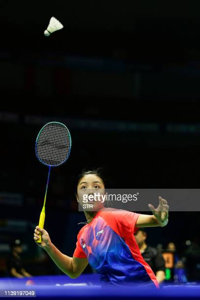 Yeo Jia Min of Singapore hits a return against Akane Yamaguchi of Japan during their women's singles second round match at the 2019 Badminton Asia...