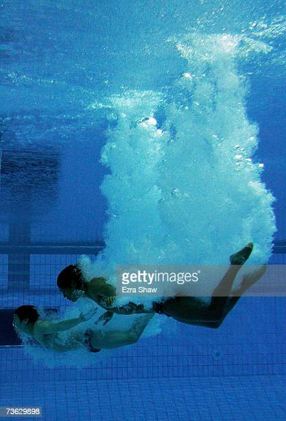 Yeoh Ken Nee and Rossharisham Roslan of Malaysia compete in the Men's 3m Synchronised Springboard final during the XII FINA World Championships on...