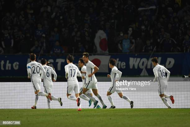 Yeom Kihun of South Korea celebrates scoring his side's fourth goal with his team mates to make 41 during the EAFF E1 Men's Football Championship...