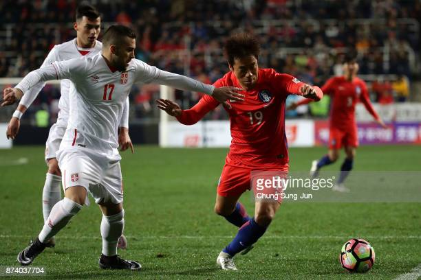Yeom KiHun of South Korea competes for the ball with Nikola Aksentijevic of Serbia during the international friendly match between South Korea and...