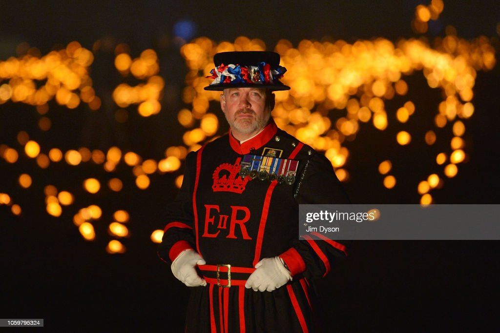 Yeoman Warders Light Torches For The Tower Of London WW1 Armistice Centenary Tribute : News Photo