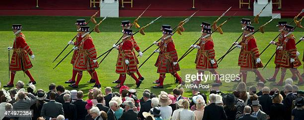 Yeoman of the Guard march to the entrance to the Royal Tea Tent as invited members of the public wait for Queen Elizabeth II to walk past as they...