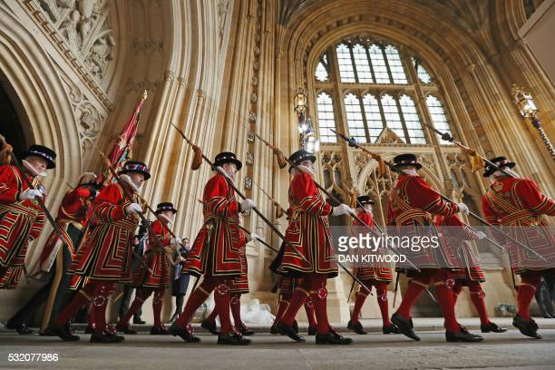 Yeoman of the Guard walk in through the Sovereign's entrance before Britain's Queen Elizabeth II and Prince Philip Duke of Edinburgh arrive at the...