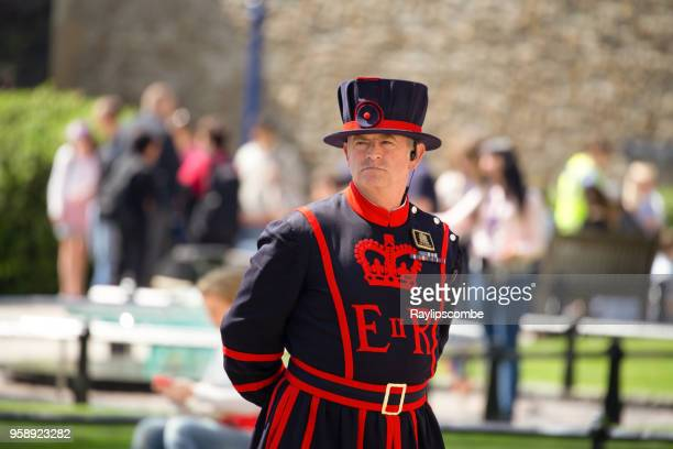A Yeoman Warder or Beefeater as they are sometimes known, standing at the Tower of London