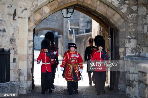 Yeoman Warders and Guardsmen march through the Byward Tower gates during a ceremonial event to mark the reopening to the public of the Tower of...