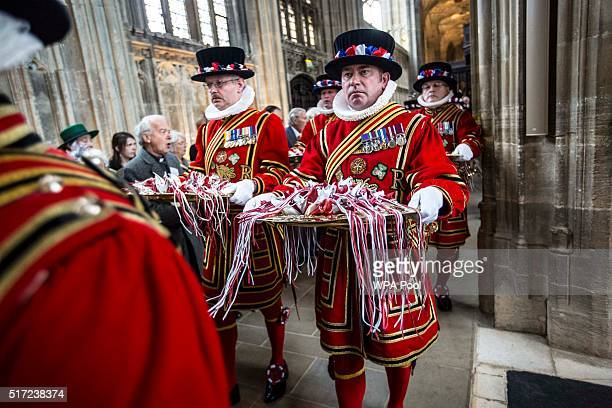 Yeoman warders carry trays containing the maundy money through St Georges chapel where The Queen distributed them to 180 people 90 men and 90 women...