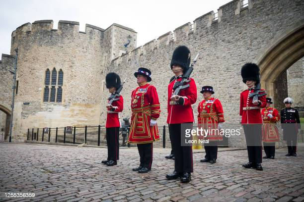 Yeoman Warders, commonly known as Beefeaters, and Guardsmen prepare to march across the Middle Drawbridge during a ceremonial event to mark the...