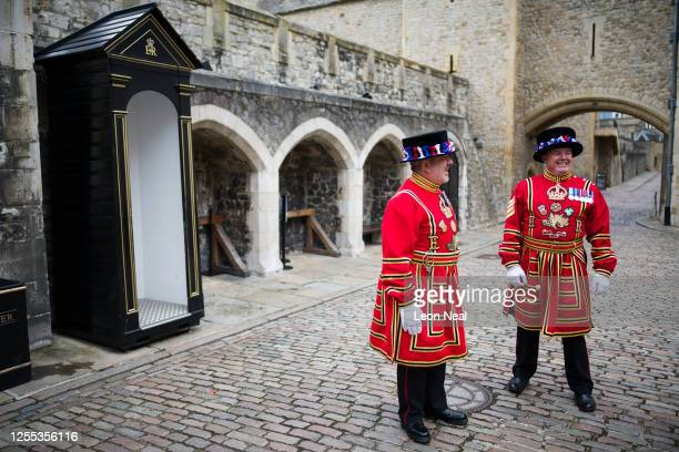 Yeoman Warders commonly known as Beefeaters chat ahead of a ceremonial event to mark the reopening to the public of the Tower of London on July 10...