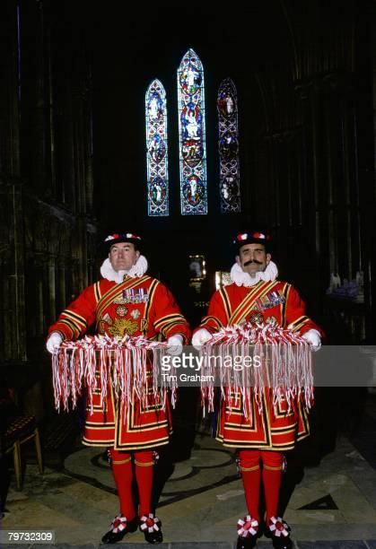 Yeomen of the Guard carry trays of Maundy Money gifts which the Queen will hand out to pensioners in recognition of their service to the community...