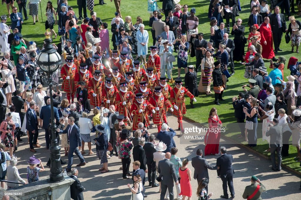 Yeomen of the Guard march during a garden party at Buckingham Palace on May 15, 2018 in London, England.