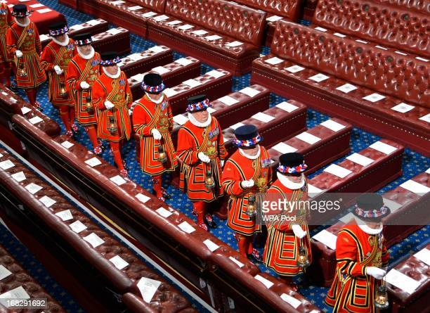 Yeomen of the Guard march through the House of Lords ahead of the State Opening of Parliament on May 8 2013 in London England Queen Elizabeth II will...