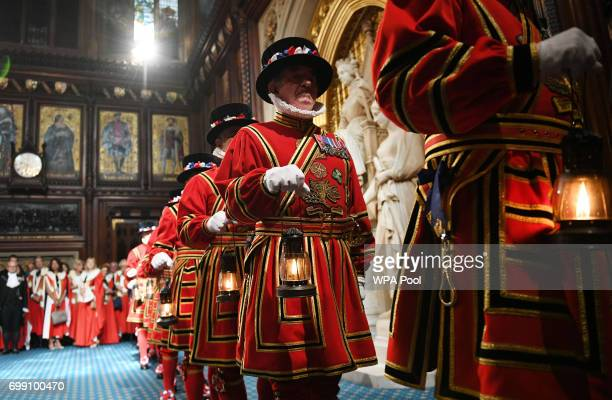 Yeomen of the Guard prepare for the ceremonial search ahead of the State Opening of Parliament by Queen Elizabeth II in the House of Lords at the...