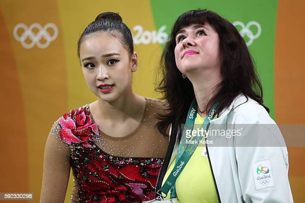 Yeon Jae Son of Korea waits for her score with her coach during the Women's Individual AllAround Rhythmic Gymnastics Final on Day 15 of the Rio 2016...