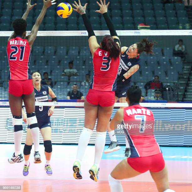 Yeon Koung Kim of South Korea competes against Lisvel Elisa Eve Mejia and Jineiry Martinez of the Dominican Republic during the FIVB Volleyball...