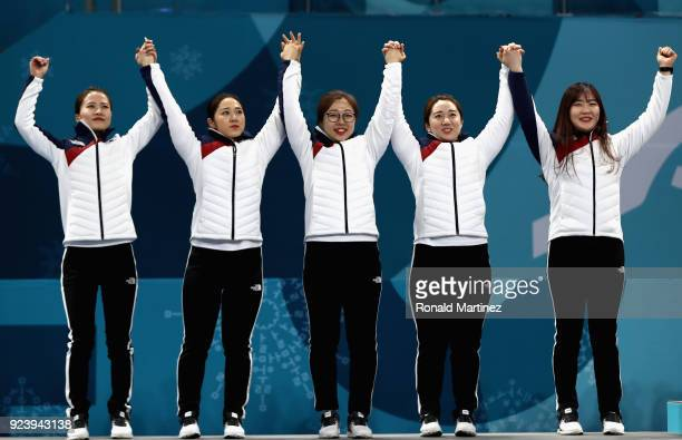 YeongMi Kim SeonYeong Kim KyeongAe Kim EunJung Kim of Korea and Chohi Kim of Korea celebrate their silver medal on the podium following the Women's...