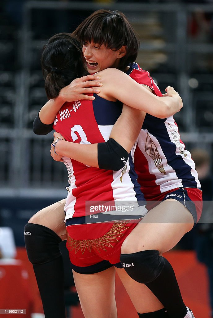 Yeon-Koung Kim #10 and Joon-Eem Ha #3 of Korea celebrate the win after defeating Italy during Women's Volleyball quarterfinals on Day 11 of the London 2012 Olympic Games at Earls Court on August 7, 2012 in London, England.