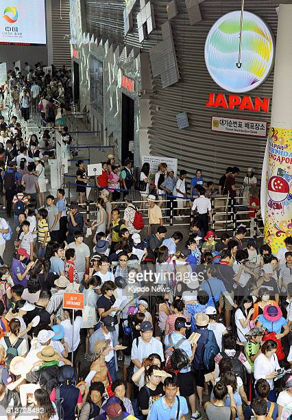 Yeosu South Korea People wait in line in front of the Japan Pavilion at Expo 2012 Yeosu Korea in the coastal city of Yeosu in southern South Korea on...