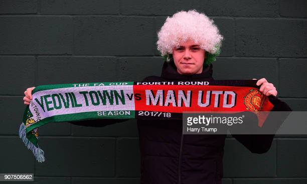 Yeovil Town fan psoes with his Half and Half scarf in preparation for the visit of Manchester United on Friday during the Sky Bet League Two match...