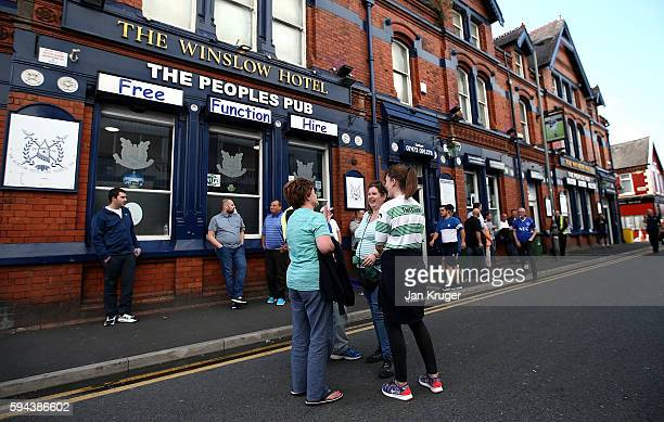 Yeovil Town fans enjoy a chat ahead of kick off during the EFL Cup match between Everton and Yeovil Town at Goodison Park on August 23 2016 in...