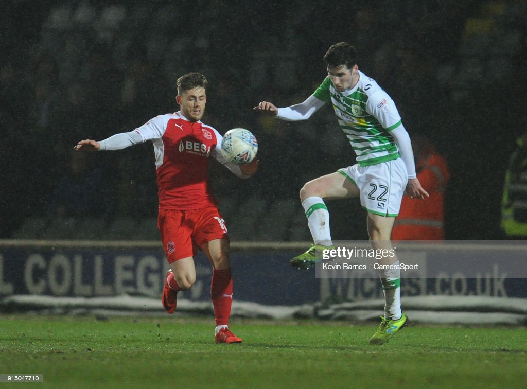Yeovil Town's Corey Whelan under pressure from Fleetwood Town's Conor McAleny during the Checkatrade Trophy Quarter-Final match between Yeovil Town and Fleetwood Town at Huish Park on February 6, 2018 in Yeovil, England.
