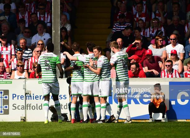 Yeovil Town's Jordan Green celebrates scoring the opening goal with team mates during the Sky Bet League Two match between Lincoln City and Yeovil...