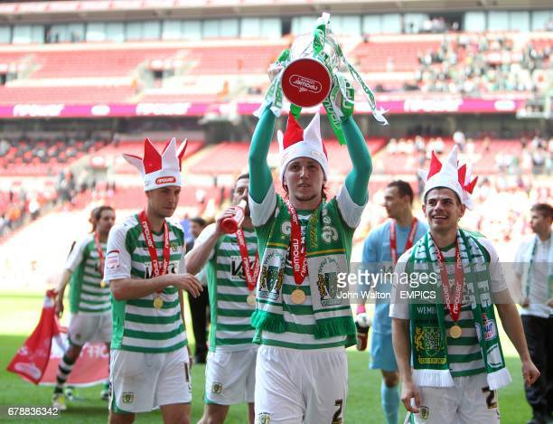 Yeovil Town's Luke Ayling celebrates with the npower Football League One play off trophy
