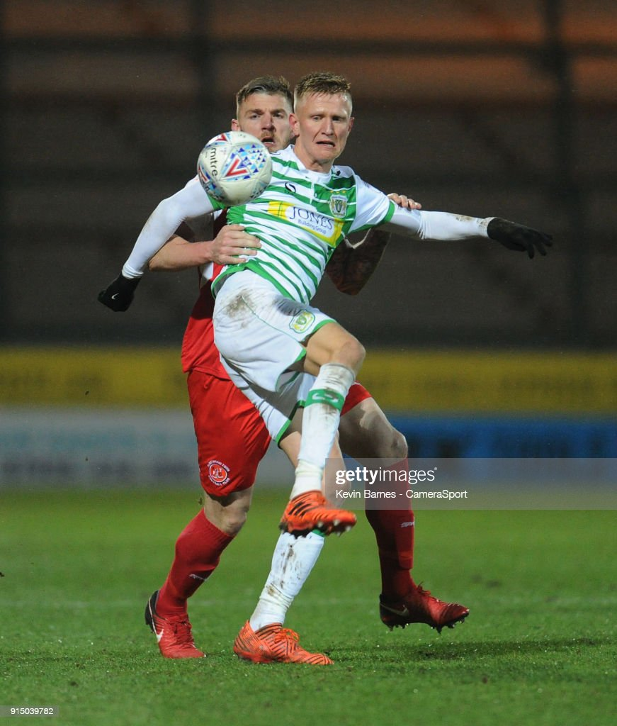 Yeovil Town's Sam Surridge under pressure from Fleetwood Town's Ashley Eastham during the Checkatrade Trophy Quarter-Final match between Yeovil Town and Fleetwood Town at Huish Park on February 6, 2018 in Yeovil, England.