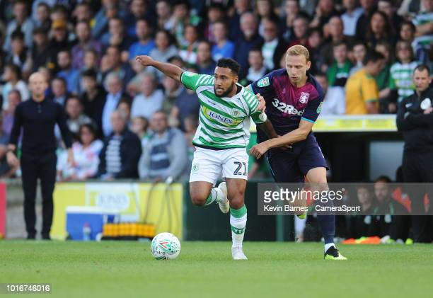 Yeovil Town's Wes McDonald under pressure from Aston Villa's Ritchie De Laet during the Sky Bet League Two match between Yevoil Town and Mansfield...