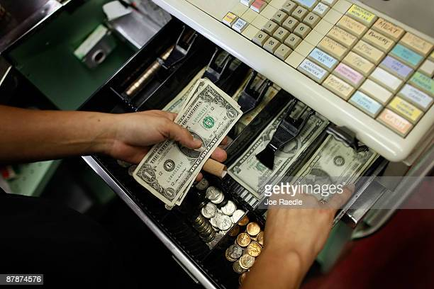 Yera Dominguez counts out change from a transaction at Lorenzo's Italian Market on May 20 2009 in Miami Florida Members of Congress today passed a...