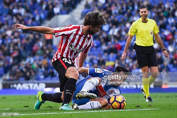 Yerai Alvarez of Athletic Club competes for the ball with Jose Manuel Jurado of RCD Espanyol during the La Liga match between RCD Espanyol and...