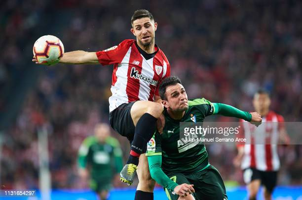 Yeray Alvarez of Athletic Club competes for the ball with Kike Garcia of SD Eibar during the La Liga match between Athletic Club and SD Eibar at San...