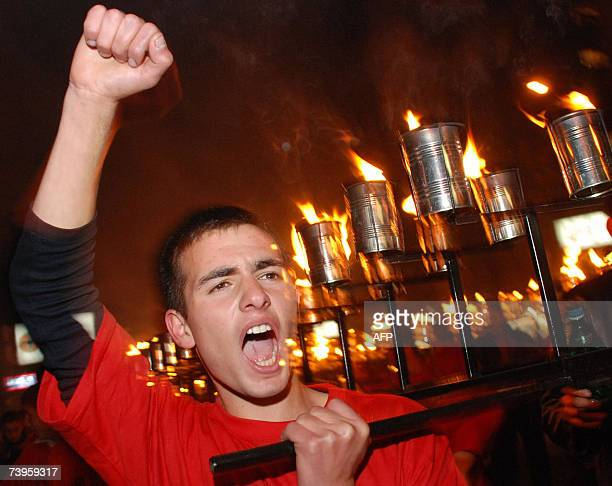 A picture taken 23 April 2007 shows a man shouting during a torchlight procession in the center of Yerevan Thousands of Armenians marched through the...