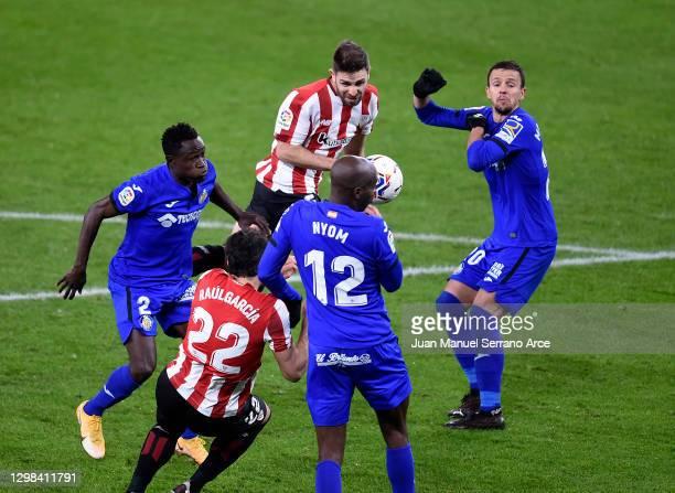 Yerey of Athletic Bilbao scores their sides second goal under pressure from Nemanja Maksimović of Getafe during the La Liga Santander match between...