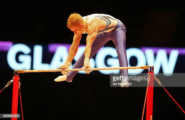 Yermak Mykyta of Ukraine goes through his routine on the High Barduring the 2015 World Artistic Gymnastics Championships Training Session at The SSE...