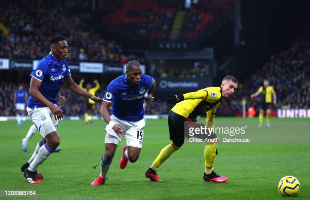 Yerry Mina and Djibril Sidibe of Everton and Gerard Deulofeu of Watford FC in action during the Premier League match between Watford FC and Everton...