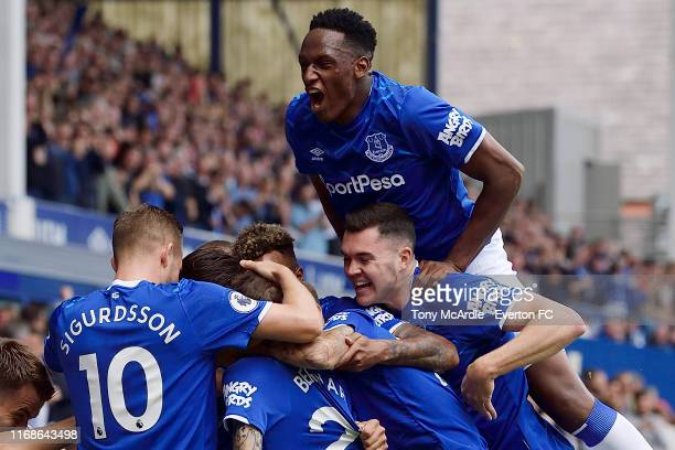 Yerry Mina and Michael Keane of Everton celebrate the goal of Bernard during the Premier League match between Everton and Watford at Goodison Park on...
