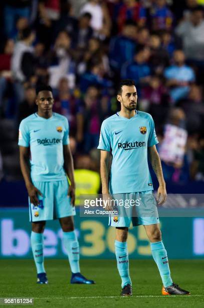 Yerry Mina and Sergio Busquets of FC Barcelona look on during the La Liga match between Levante UD and FC Barcelona at Estadi Ciutat de Valencia on...