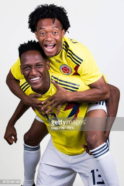 Yerry Mina of Colombia and Juan Cuadrado pose for a portrait during the official FIFA World Cup 2018 portrait session at Kazan Ski Resort on June 13...