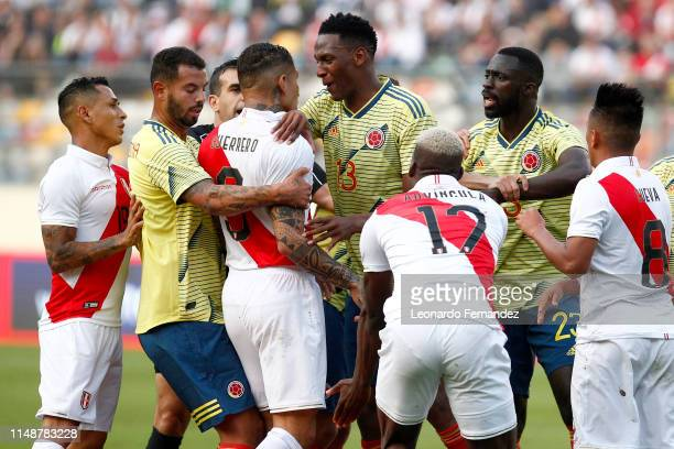 Yerry Mina of Colombia argues with Paolo Guerrero of Peru during a friendly match between Peru and Colombia at Estadio Monumental de Lima on June 9...
