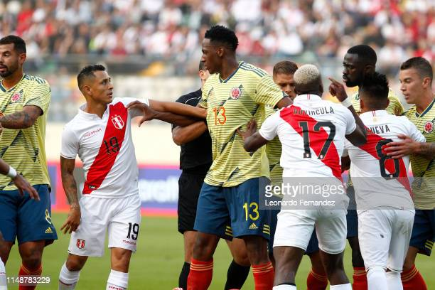 Yerry Mina of Colombia argues with Yoshimar Yotun of Peru during a friendly match between Peru and Colombia at Estadio Monumental de Lima on June 9...