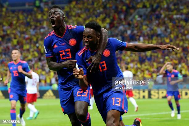 Yerry Mina of Colombia celebrates after scoring his team's first goal with Davinson Sanchez of Colombia during the 2018 FIFA World Cup Russia group H...
